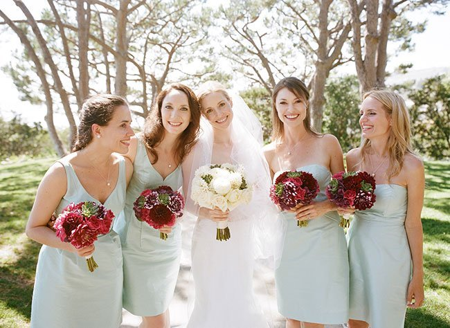 Summer wedding bridal party with their bouquets